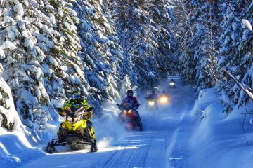 Snowmobiles on trail Big White Ski Resort