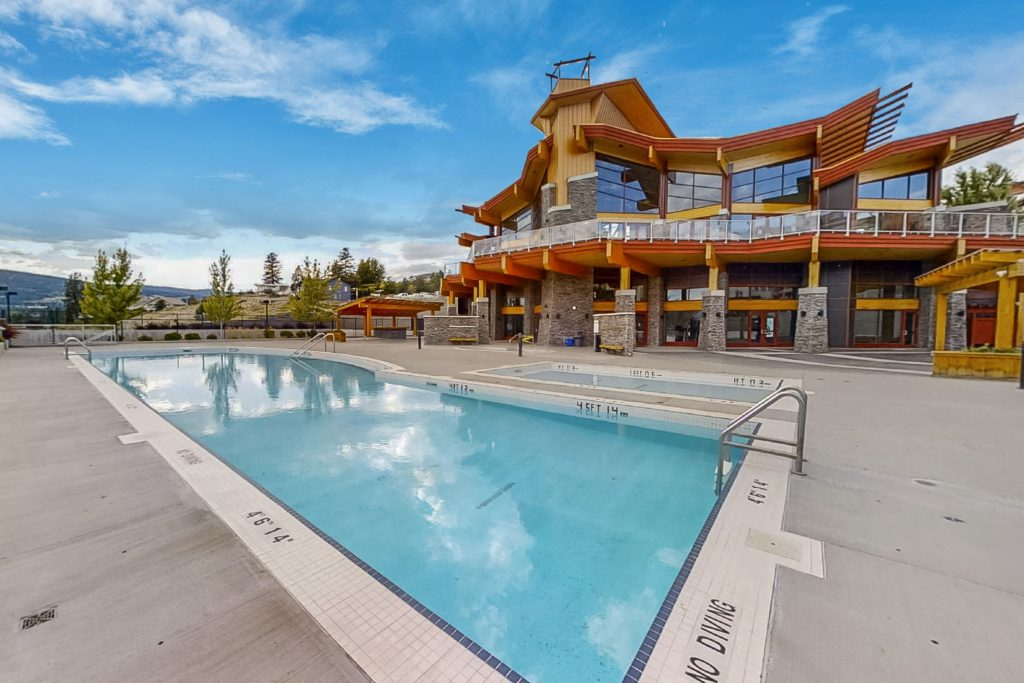 View of pool and clubhouse at copper sky